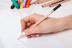 Drawing a sketch. A closeup of a hand drawing a sketch with a pencil Royalty Free Stock Photos
