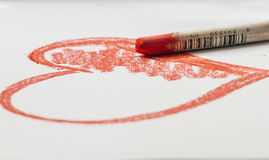Drawing a sketch of the heart bu chalk. Drawing a sketch of the heart Royalty Free Stock Image