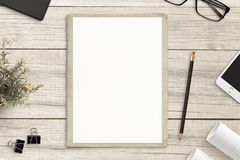Drawing sketches concept with empty paper on wooden desk stock photo