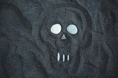 Drawing of the skull on the black sand. Beach in Iceland stock image
