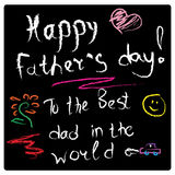 Drawing on a slate black Board with chalk greetings on father`s day. Drawing on a slate blackboard with chalk message on a father`s day text Royalty Free Stock Photography