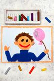 Drawing: Smiling boy with pink balloon in his hand royalty free stock image