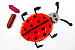 Drawing: Smiling ladybug on white paper background, with crayons. Photo of colorful drawing: Smiling ladybug on white paper background, with crayons Royalty Free Stock Photo