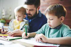 Drawing with sons Royalty Free Stock Image