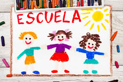 Drawing: Spanish word SCHOOL and happy children. Photo of  colorful drawing: Spanish word SCHOOL and happy children. First day at school Stock Photo