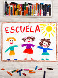 Drawing: Spanish word SCHOOL and happy children. Photo of  colorful drawing: Spanish word SCHOOL and happy children. First day at school Stock Photos