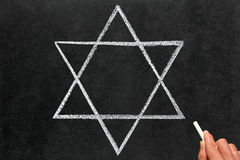 Drawing the Star of David Judaism religious symbol Royalty Free Stock Photos