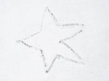 Drawing star on snow Stock Photos