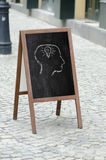 Drawing on a street restaurant menu blackboard Stock Photography
