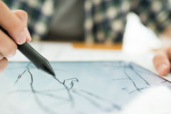 Drawing with stylus Royalty Free Stock Photos