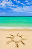 Drawing sun on beach Royalty Free Stock Image
