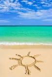 Drawing sun on beach Royalty Free Stock Image