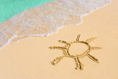 Drawing sun on beach Stock Image
