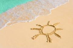 Drawing sun on beach Stock Image