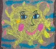 Drawing of the sun is on the pavement Royalty Free Stock Photography