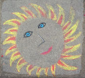 Childrens drawing of sun with chalk Royalty Free Stock Photography