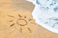 Drawing of sun in the sand Stock Image