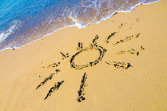Drawing of sun in the sand Stock Photos