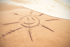 Drawing of a sun in the sand Stock Photos