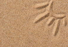 Drawing sun on the sand Royalty Free Stock Photo