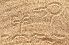 Drawing sun, waves and island on the sand Royalty Free Stock Image
