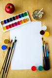 Drawing supplies watercolor brushes, aquarelle, gouache, paper on wooden background Stock Photography