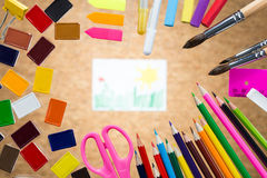 Drawing surrounded with colorful tools Stock Photo
