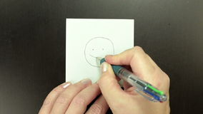 Drawing the symbol Big Grin stock footage