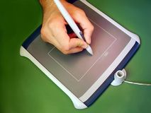 Drawing tablet. A hand using a drawing tablet stock photo