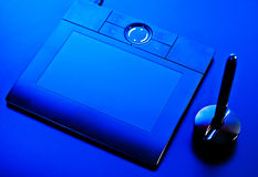 Drawing tablet in blue light Royalty Free Stock Image