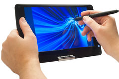 Drawing on tablet pc. Drawing blue curved lines with pen on touch screen tablet pc isolated Stock Images