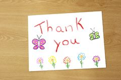 Drawing of thanks to the teacher. On a sheet of paper on the table stock image