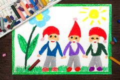 Drawing: three smiling dwarfs in red hats Stock Images