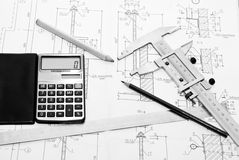 Drawing and tool. Professional architecture drawings and working tools Royalty Free Stock Photos