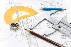 Drawing and tool. Professional architecture drawings and working tools Royalty Free Stock Photography