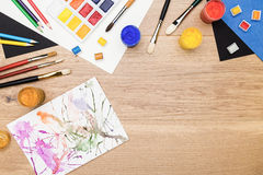 Drawing tools and abstract painting Royalty Free Stock Photo