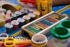Drawing tools. Tools for drawing and creativity: paint, scissors, pastels, glue stock images