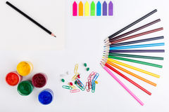 Drawing tools and stationery. Colorful pencils, gouache paint, stickers, clips and pins on white background Royalty Free Stock Photography