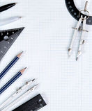 Drawing tools on white notebook sheet in the box Stock Photo