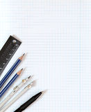 Drawing tools on white notebook sheet in the box Royalty Free Stock Photo