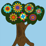 Drawing a tree on a blue background. With ethnic circles Royalty Free Stock Photography