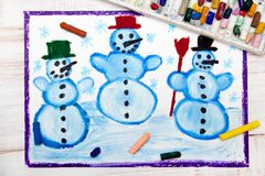 Drawing: tree happy snowmans and snowflakes. Photo of colorful hand drawing: tree happy snowmans and snowflakes Royalty Free Stock Images