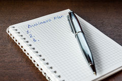 Drawing up the business plan, write in the notebook Royalty Free Stock Photos