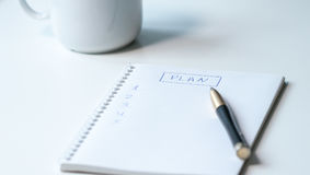 Drawing up the plan. Notebook on office desk Royalty Free Stock Photo