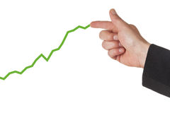 Drawing an upward graph. Businessman drawing upward graph with his finger Royalty Free Stock Photography