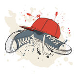 Drawing vector illustration with sneakers and baseball cap Royalty Free Stock Photography