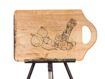 Drawing of vegetable on wooden chopping board place on metal eas Royalty Free Stock Images