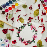 Drawing with watercolor. Flat lay, top view, wreath frame Stock Images