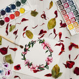 Drawing with watercolor. Flat lay, top view, wreath frame Royalty Free Stock Photography