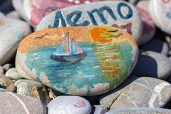 The drawing watercolor paints on a beach stone. The drawing of the sailing vessel watercolor paints on a beach stone Stock Photos